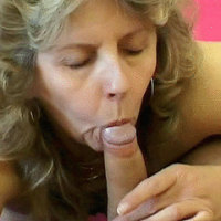Wrinkled Mature Mouthing a Dick